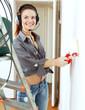 girl in headphones paints wall