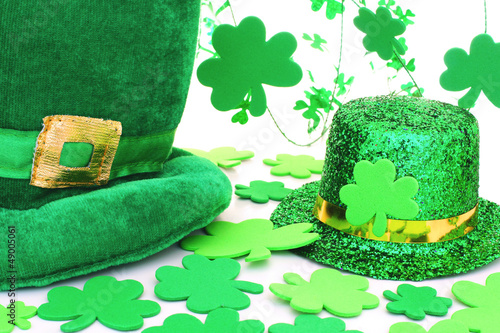 St Patrick's Day hats with shamrocks over white