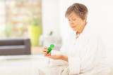 senior woman taking pills at home