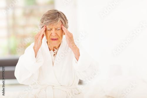 senior woman feeling headache at home