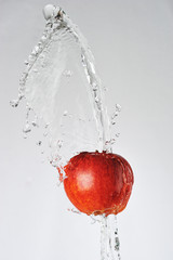Red apple and water splash
