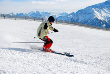 male skier moving down a ski track