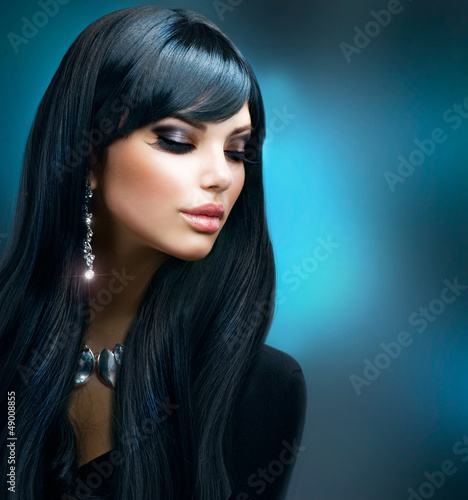 Brunette Girl. Healthy Long Hair and Holiday Makeup