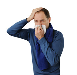 Man blowing his nose and holding his head isolated on white
