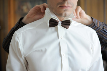 Putting on Bow Tie