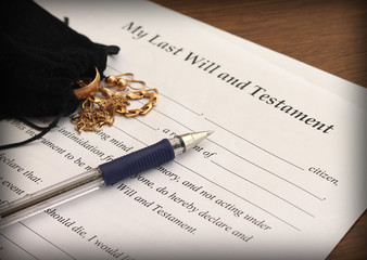 Last Will and Testament form with gold jewelry