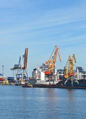 Cargo crane, ship, freight traine and coal in port