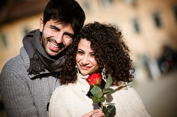 Young couple with rose, outdoors