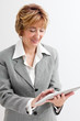 Mature  Businesswoman using Digital Tablet