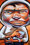 GRAFFITI DE UN HOMBRE, CON GORRO ACARICIANDO UN GATO poster