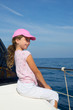 child happy girl sailing happy  boat with cap