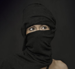 Asian woman black hijab that shows only the eyes