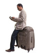traveler holding sitting on big suitcase