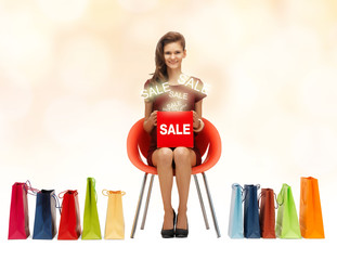 girl in red dress with shoes, bag and sale sign