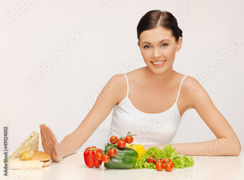 woman with hamburger and vegetables