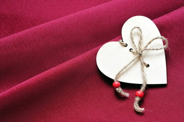 Wooden heart on fabric background