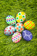 Easter eggs background on grass