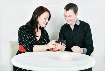 Man and woman talking using telephone