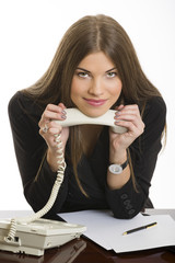Smiling business woman with phone receiver