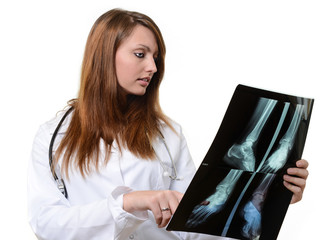 female doctor looking at X-ray image