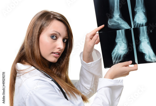 Attractive female doctor looking at X-ray image