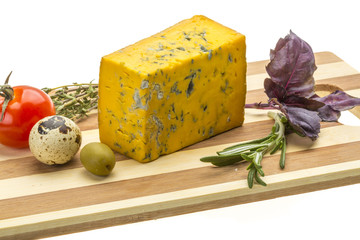 Yellow cheese with blue mold