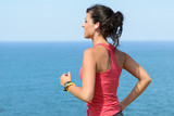 Woman exercising on summer at seaside