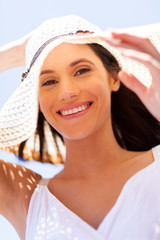 happy young woman with summer hat