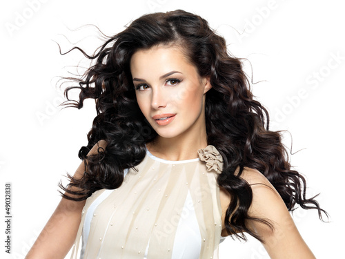 Beautiful brunette woman with beauty long curly hair.