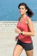 Fitness girl running on summer