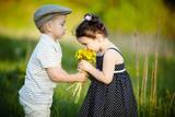 cute boy and girl on summer field - Fine Art prints