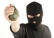 Masked man bomber aims with hand grenade
