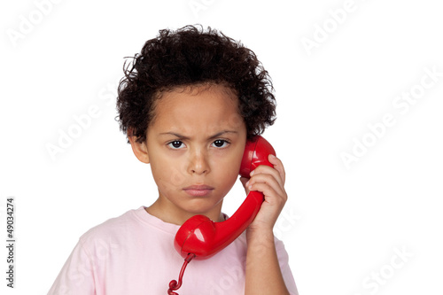 Angry latin child with red phone