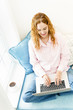 Woman using laptop computer at home