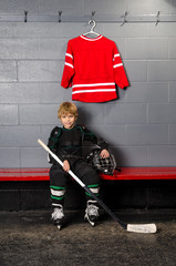 Young Boy in Hockey Dressing Room