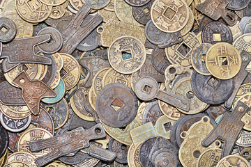 Variety of ancient Chinese coins with different forms and shapes
