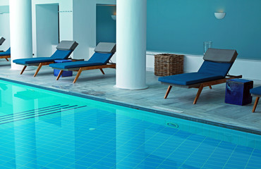 Blue resort pool interior with pool bed