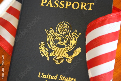 US passport over An American flag (Travel Concept)
