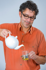 man is drinking tea