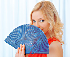 Young girl with fan