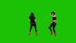 Two women dance against green screen