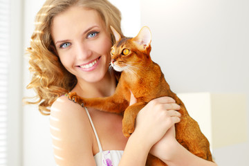 girl with Abyssinian cat