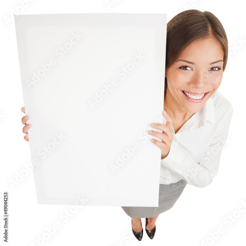 Woman showing a white board sign poster