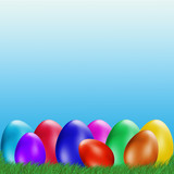 Easter background. Easter eggs laying in green grass