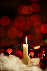 Burning candle in christmas decoration