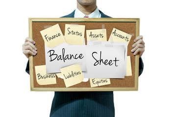 Business man holding board on the background, Balance Sheet