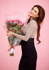 Beautiful woman with large bouquet of roses