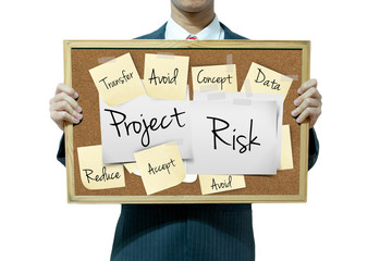 Business man holding board on the background, Risk Management