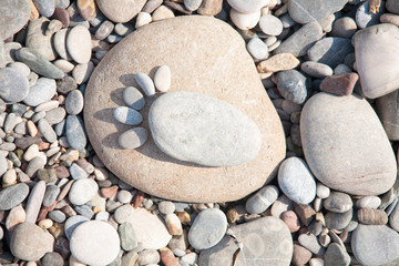 sea ​​stones laid out in the form of foot prints