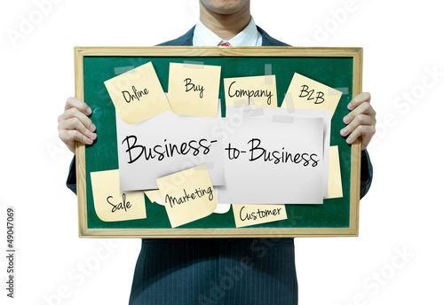 Business man holding board on the background, Business to Busine